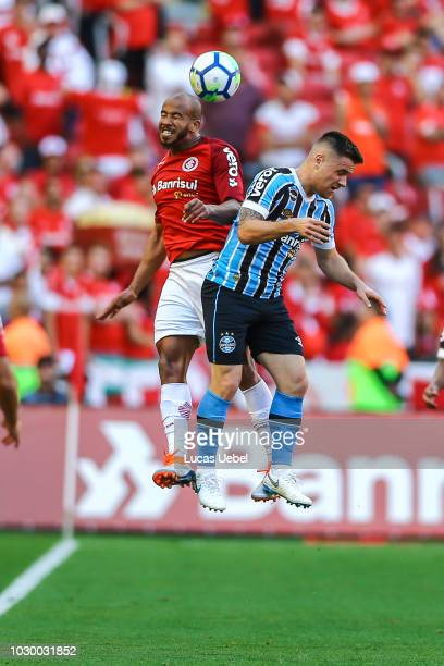Patrick of Internacional battles for the ball against Ramiro of Gremio during the match between Internacional and Gremio as part of Brasileirao...