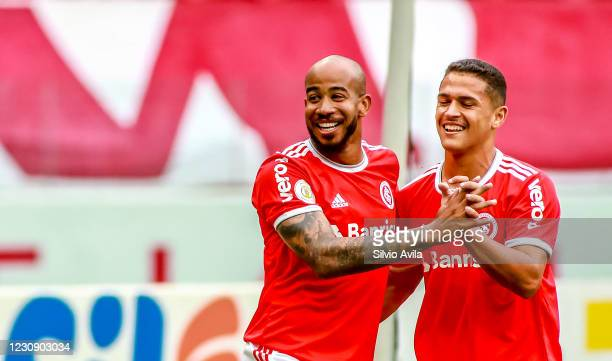 Patrick of Internacional celebrates with teammate after scoring the first goal of his team during the match between Internacional and Red Bull...