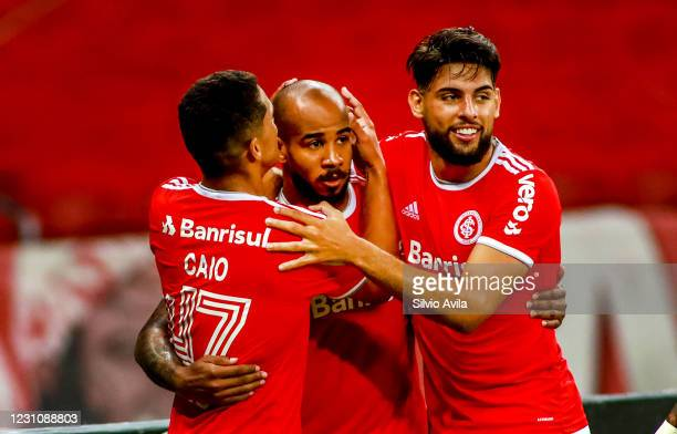 Patrick of Internacional celebrates with teammates after scoring the first goal of their team during the match between Internacional and Sport Recife...