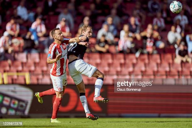 Patrick Olsen of AaB Aalborg and $Benjamin Hvidt of AGF Aarhus compete for the ball during the Danish 3F Superliga match between AaB Aalborg and AGF...
