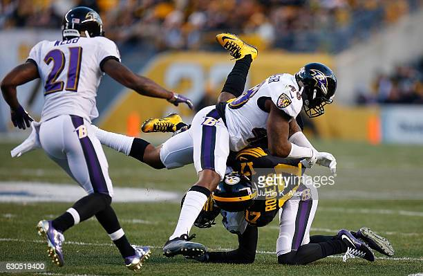 Patrick Onwuasor of the Baltimore Ravens tackles Eli Rogers of the Pittsburgh Steelers in the first quarter during the game at Heinz Field on...
