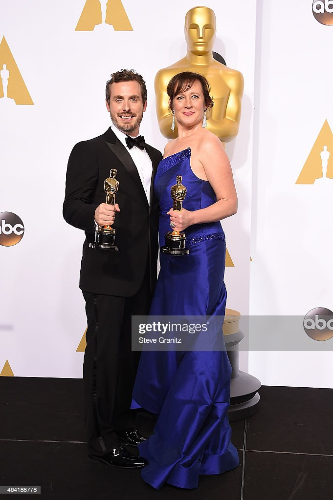 Patrick Osborne and Kristina Reed pose with their award in the press room during the 87th Annual Academy Awards at Loews Hollywood Hotel on February 22, 2015 in Hollywood, California.