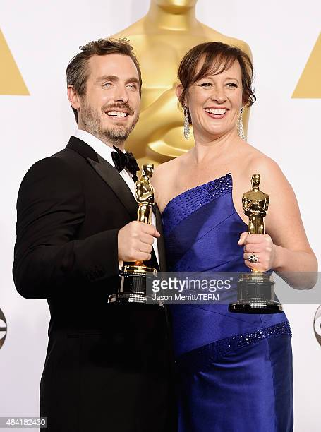 Patrick Osborne , and Kristina Reed winners of the Best Animated Short Film Award for 'Feast' poses in the press room during the 87th Annual Academy...