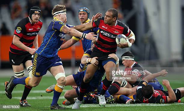 Patrick Osborne of Canterbury puts a fend on James Lentjes of Otag during the round one ITM Cup match between Otago and Canterbury at Forsyth Barr...