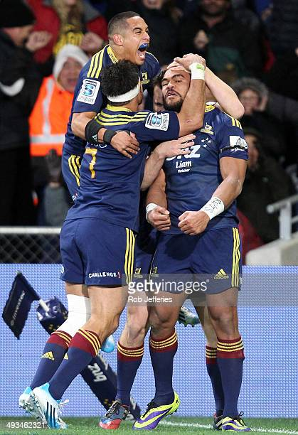Patrick Osborne of the Highlanders celebrates his try with his teammates during the round 15 Super Rugby match between the Highlanders and the...