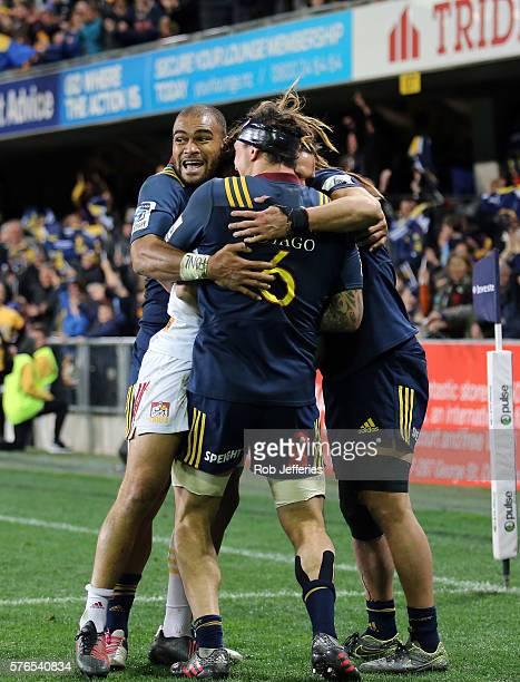 Patrick Osborne of the Highlanders celebrates the try of Dan Pryor during the round 17 Super Rugby match between the Highlanders and the Chiefs at...