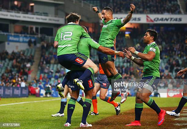 Patrick Osborne of the Highlanders celebrates with Richard Buckman and Aaron Smith after scoring the final try during the Super Rugby Semi Final...