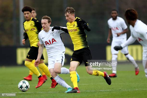 Patrick Osterhage of Dortmund challenges Oliver Skipp of Tottenham during the UEFA Youth League match between Borussia Dortmund and Tottenham Hotspur...