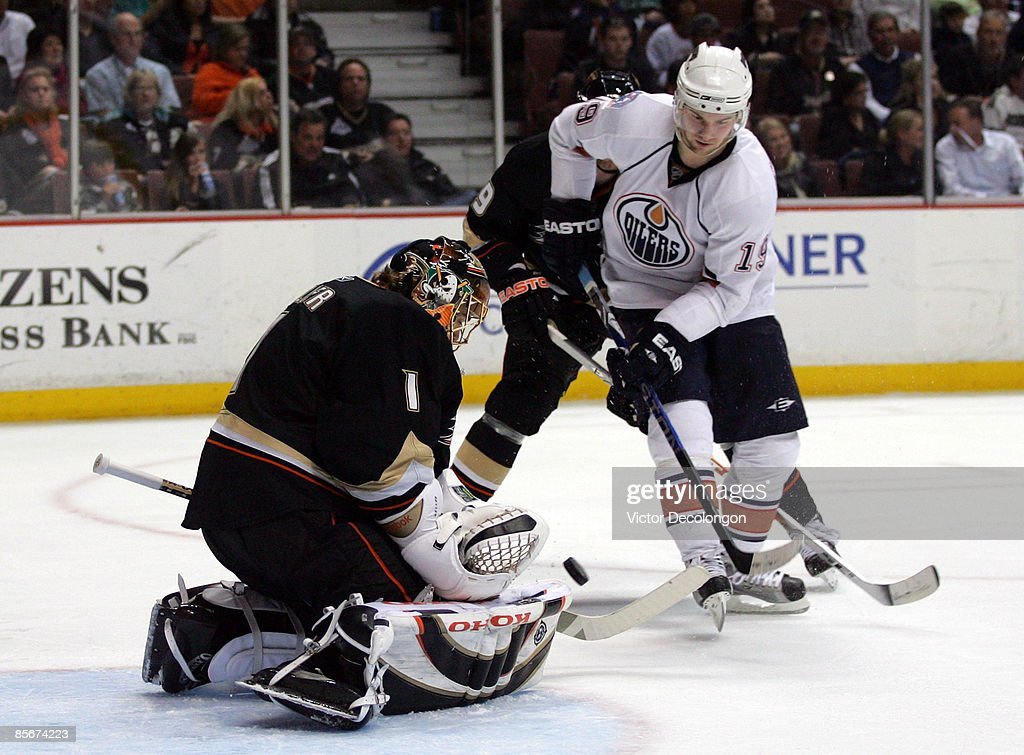 Patrick O'Sullivan #19 of the Edmonton Oilers looks for the rebound as goaltender Jonas Hiller #1 of the Anaheim Ducks makes a save in the second period during the NHL game at Honda Center on March 27, 2009 in Anaheim, California. The Oilers defeated the Ducks 5-3.