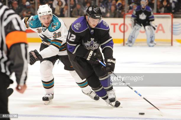 Patrick O'Sullivan of the Los Angeles Kings handles the puck while being pursued by Tomas Plihal of the San Jose Sharks on October 12 2008 at Staples...