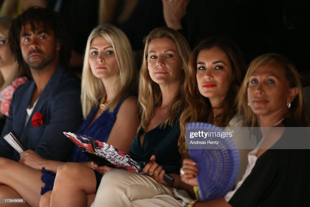 Patrick Owomoyela, Josipa, Sophie Schuett and Jana Ina Zarrella attend the Laurel Show during the Mercedes-Benz Fashion Week Spring/Summer 2014 at Brandenburg Gate on July 4, 2013 in Berlin, Germany.