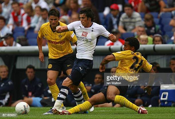 Patrick Owomoyela of Borussia Dortmund tries to tackle Gareth Bale of Tottenham Hotspur during the Port of Rotterdam Tournament match between...