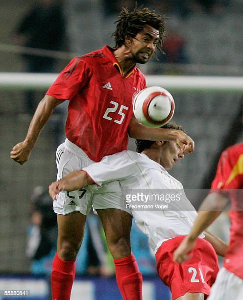 Patrick Owomoyela of Germany challenges for the ball with Halil Altintop of Turkey during the friendly match between Turkey and Germany at the...