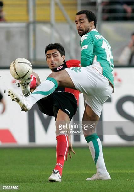 Patrick Owomoyela of Werder Bremen challenges Chris of Eintracht Frankfurt during the Bundesliga match between Eintracht Frankfurt and Werder Bremen...