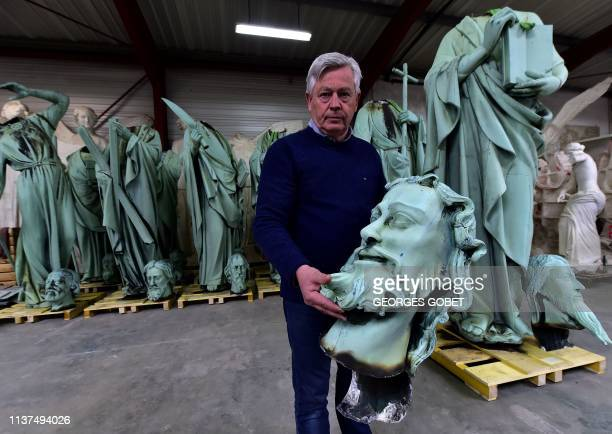 Patrick Palem expert of the heritage restoration shows the head of a one of the statues which sat around the spire of the NotreDame cathedral in...