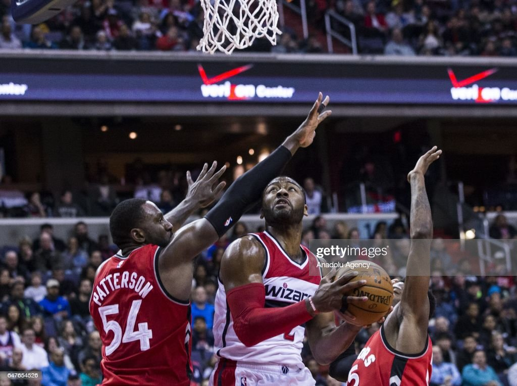 Patrick Patterson (54) and Delon Wright (55) of Toronto Raptors in action against John Wall (2) of Washington Wizards during the NBA match between Washington Wizards and Toronto Raptors at the Verizon Center in Washington, United States on March 3, 2017.
