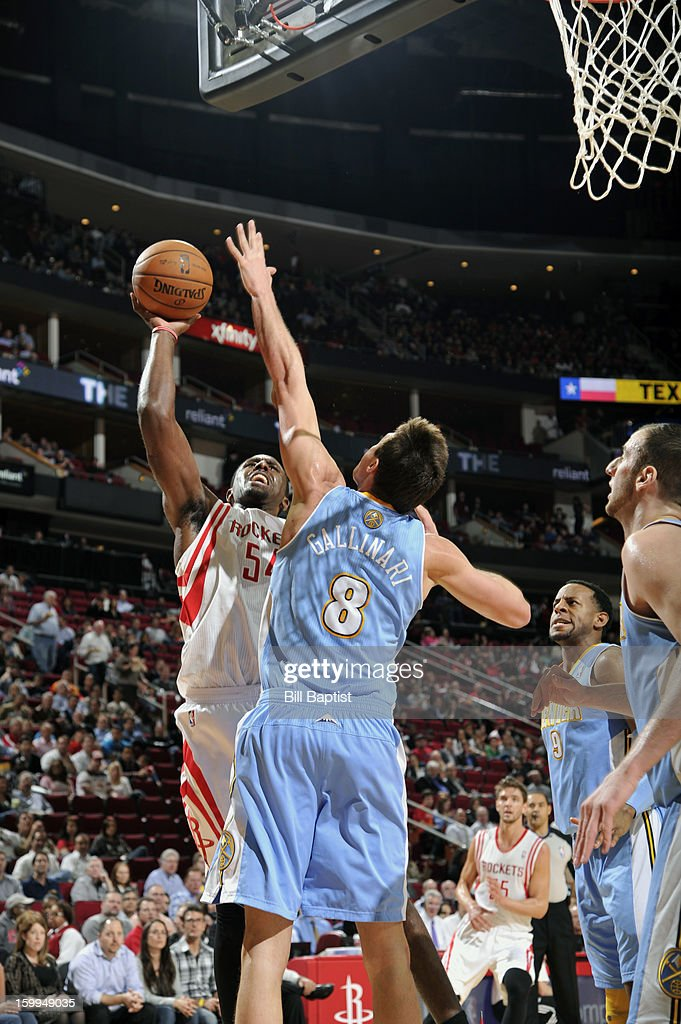 Patrick Patterson #54 of the Houston Rockets shoots the ball over Danilo Gallinari #8 of the Denver Nuggets on January 23, 2013 at the Toyota Center in Houston, Texas.