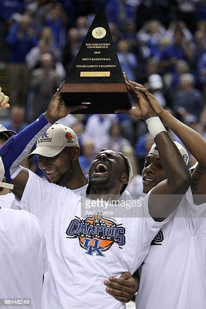 Patrick Patterson of the Kentucky Wildcats celebrates with the SEC conference tournament championship trophy after Kentucky won 7574 in overtime...