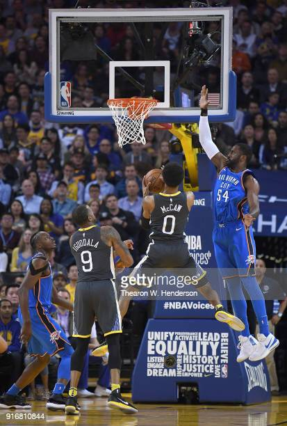 Patrick Patterson of the Oklahoma City Thunder leaps to defend the shot of Patrick McCaw of the Golden State Warriors during the first half of their...