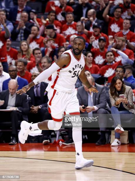 Patrick Patterson of the Toronto Raptors celebrates after hitting a three pointer against the Milwaukee Bucks during Game Five of the Eastern...