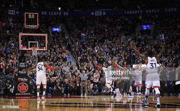 Patrick Patterson of the Toronto Raptors celebrates after sinking a buzzer beater from over half to end the 1st quarter of an NBA game against the...