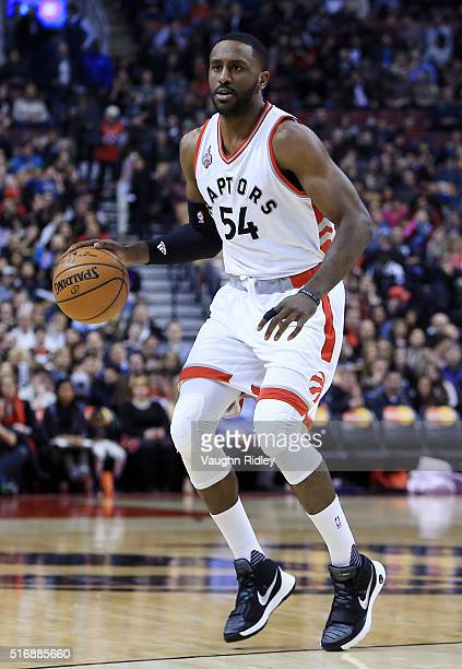 Patrick Patterson of the Toronto Raptors dribbles the ball during the first half of an NBA game against the Boston Celtics at the Air Canada Centre...