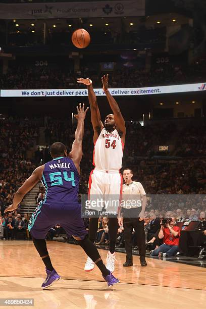 Patrick Patterson of the Toronto Raptors shoots against Jason Maxiell of the Charlotte Hornets during the game on April 15 2015 at Air Canda Centre...