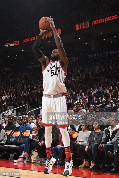 Patrick Patterson of the Toronto Raptors shoots the ball against the Sacramento Kings on December 20 2015 at the Air Canada Centre in Toronto Ontario...