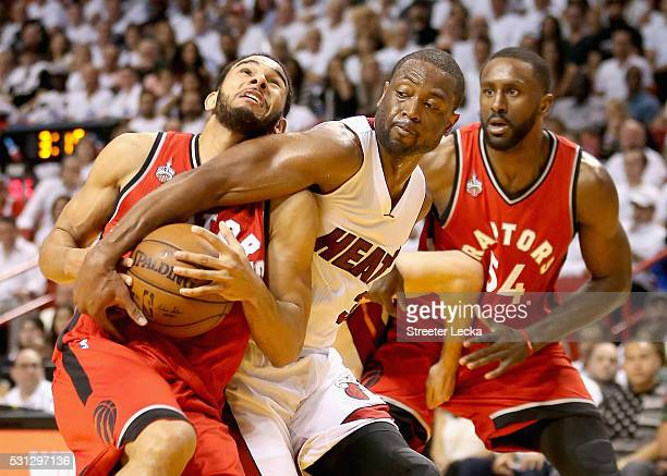 Patrick Patterson watches as teammate Cory Joseph of the Toronto Raptors has the ball taken by Dwyane Wade of the Miami Heat during Game 6 of the...
