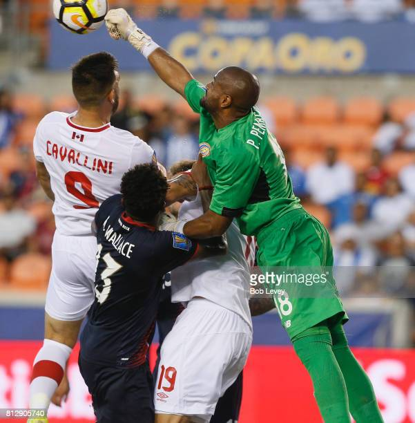 Patrick Pemberton of Costa Rica make a save before Lucas Cavallini of Canada can get his head on the ball in the second half at BBVA Compass Stadium...