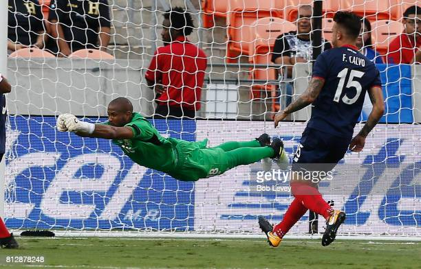 Patrick Pemberton of Costa Rica makes a diving save against the Canada in the first half at BBVA Compass Stadium on July 11, 2017 in Houston, Texas.