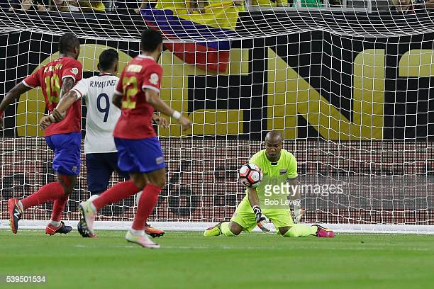Patrick Pemberton of Costa Rica makes a save as Roger Martinez of Colombia looks for a rebound as Kendall Watson defends along with Ronald Matarrita...