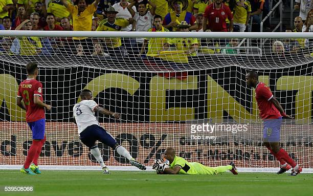 Patrick Pemberton of Costa Rica makes a save before Yerry Mina of Colombia can get his foot on a rebound as Francisco Calvo and Kendall Watson look...