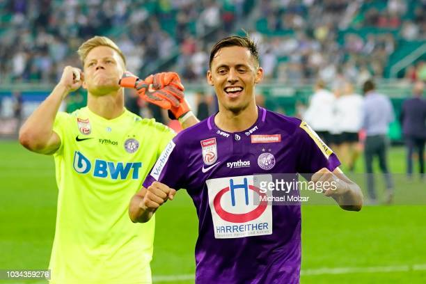 Patrick Pentz of Austria Wien and Uros Matic of Austria Wien are celebrating the victory of their team during the tipico Bundesliga match between...