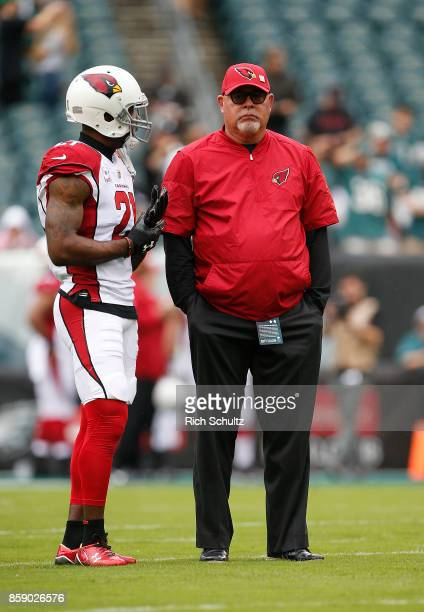 Patrick Peterson and head coach Bruce Arians of the Arizona Cardinals talk before a game against the Philadelphia Eagles at Lincoln Financial Field...