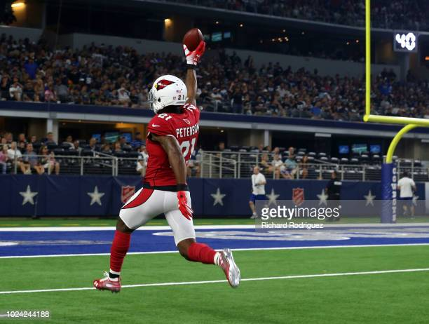 Patrick Peterson of the Arizona Cardinals carries the ball to the end zone for a touchdown after an interception in the first quarter of a preseason...