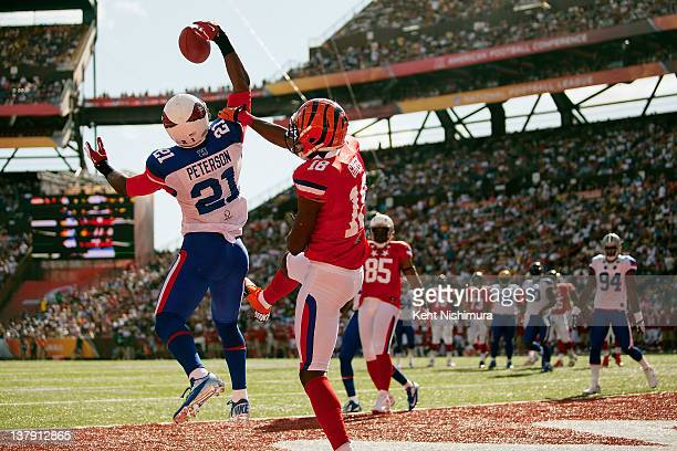Patrick Peterson of the Arizona Cardinals intercepts a pass meant for AJ Green of the Cincinnati Bengals during the 2012 NFL Pro Bowl between the AFC...