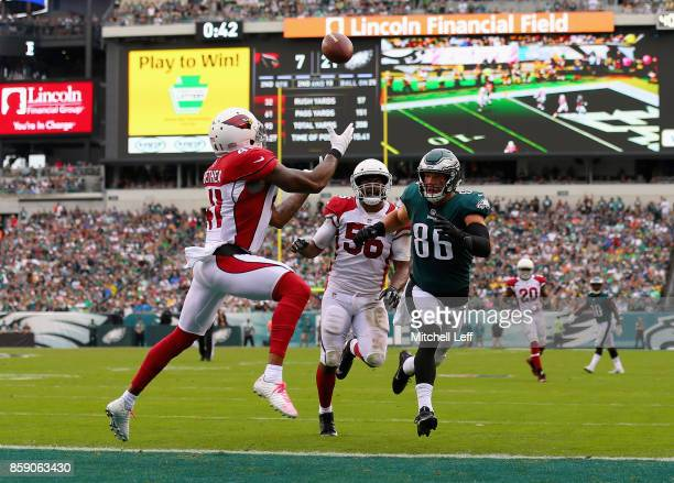 Patrick Peterson of the Arizona Cardinals makes an interception against Zach Ertz of the Philadelphia Eagles during the second quarter at Lincoln...