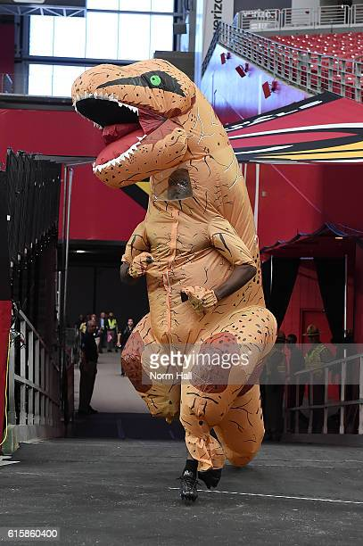 Patrick Peterson of the Arizona Cardinals runs onto the field wearing inflatable T-Rex costume prior to a game against the New York Jets at...