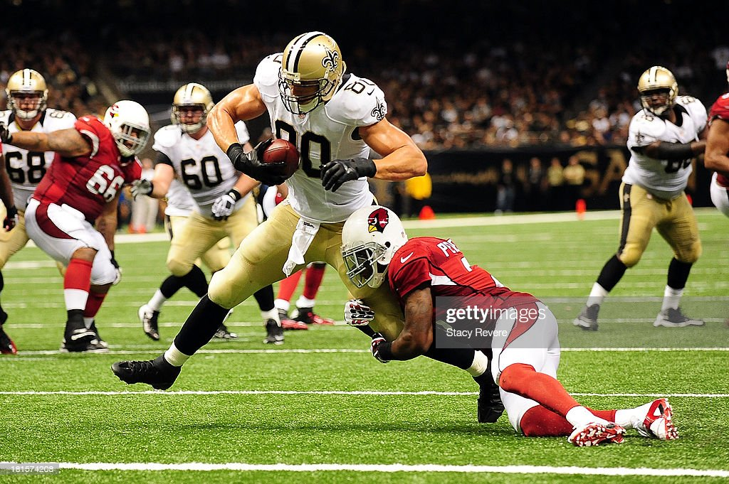 Patrick Peterson #21 of the Arizona Cardinals tries to tackle Jimmy Graham #80 of the New Orleans Saints during a game at the Mercedes-Benz Superdome on September 22, 2013 in New Orleans, Louisiana. The Saints defeated the Cardinals 31-7.
