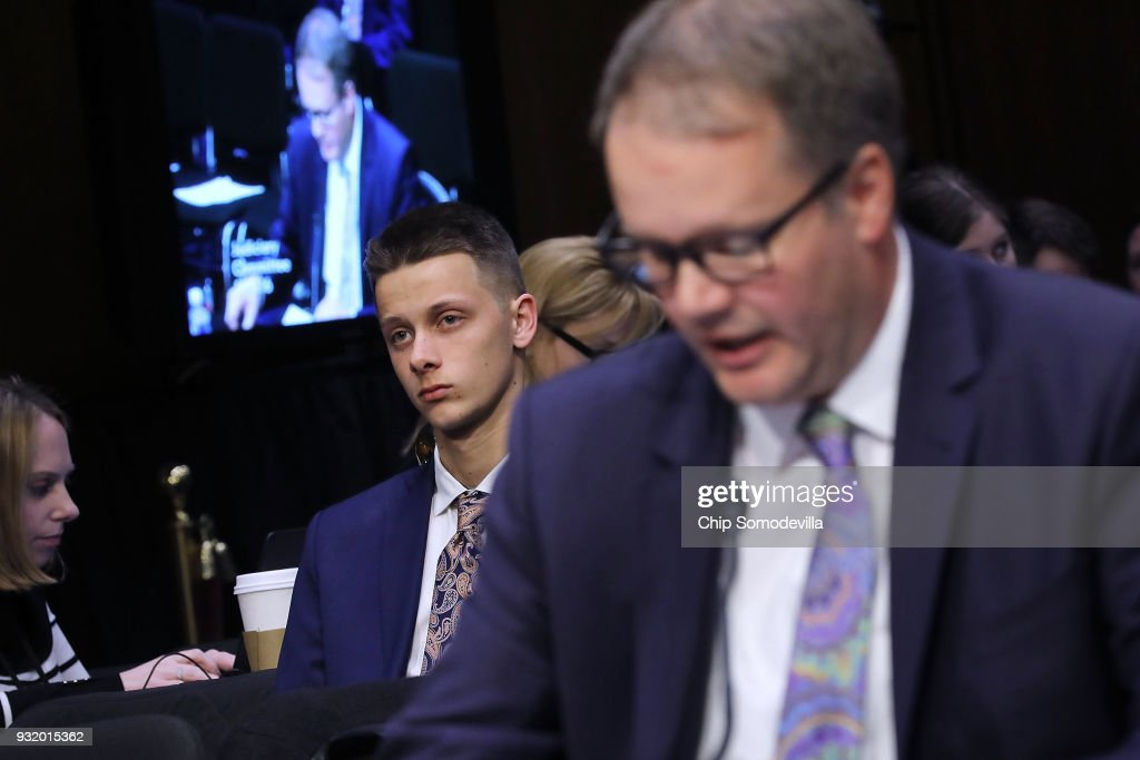 Patrick Petty (C) listens as his father Ryan Petty, talks about his daughter Alaina Petty, a student killed in the February 14 shooting in Parkland, Florida, while testifying before the Senate Judiciary Committee about the massacre at Marjory Stoneman Douglas High School in the Hart Senate Office Building on Capitol Hill March 14, 2018 in Washington, DC. Law enforcement officials testified that more could have and should have done to stop the school shooter Nikolas Cruz after they receieved several tips about him.