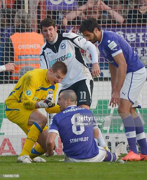 Patrick Platins of Bielefeld celebrates in front of Timo Staffeldt of Osnabrueck who missed a penalty during the Third League match between between...