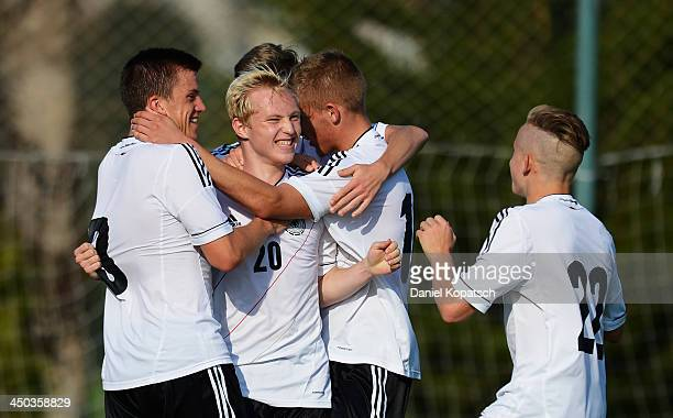Patrick Pluecke of Germany celebrates his team's first goal with team mates during the U18 international friendly match between Turkey and Germany on...