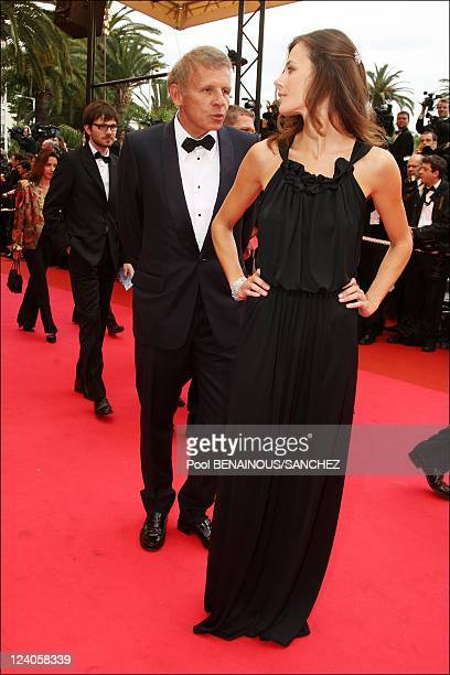 Patrick Poivre d'Arvor and his girlfriend on the stairs of 'Un conte de Noel' at the Cannes film festival In Cannes France On May 16 2008 Patrick...