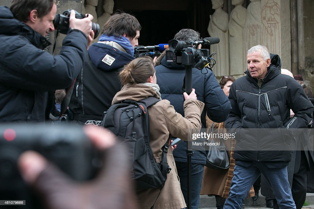 Patrick Poivre d'Arvor (R) leaves the funeral of journalist Jacques Chancel at Saint-Germain-des-Pres church on January 6, 2015 in Paris, France.