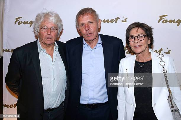 Patrick Poivre d'Arvor standing between Director JeanJacques Annaud and his wife Laurence DuvalAnnaud attend the Fouquet's Paris Restaurant presents...