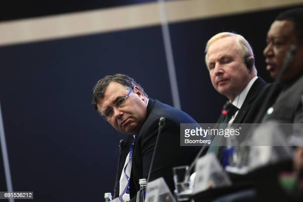 Patrick Pouyanne chief executive officer of Total SA left looks on during a panel session with Bob Dudley chief executive of BP Plc center and...