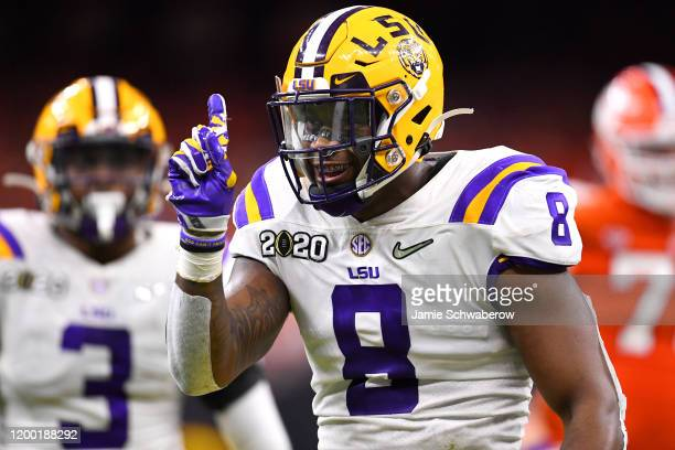 Patrick Queen of the LSU Tigers celebrates a defensive stop against the Clemson Tigers during the College Football Playoff National Championship held...
