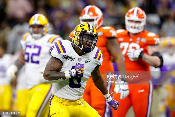 Patrick Queen of the LSU Tigers celebrates a huge defensive stop against Clemson Tigers in the College Football Playoff National Championship game at...