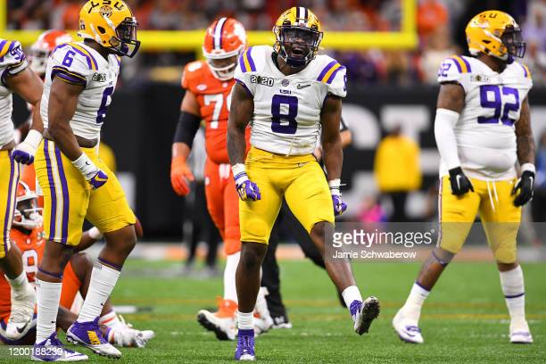 Patrick Queen of the LSU Tigers celebrates a tackle against Travis Etienne of the Clemson Tigers during the College Football Playoff National...